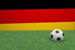 Calcio in Front Of German Flag Immagine Stock Libera da Diritti
