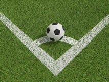Calcio o calcio nel campo di erba verde su conner Fotografie Stock