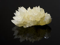 Calcite crystals on a reflective surface Stock Image