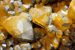 Calcite mine in gold color. Background in color and shape of calcite mine, shown as beautiful and featured color, pattern and texture Royalty Free Stock Photos