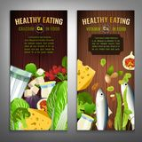 Calcium in Food Banners. Vertical banner layouts. Source of Calcium - vegetables, salads, greens, fruits, dairy products on a wooden background. Medical Royalty Free Stock Photos