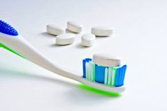Calcium Tablet on Toothbrush Royalty Free Stock Image
