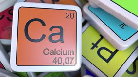 Calcium block on the pile of periodic table of the chemical elements blocks. Chemistry related 3D rendering. Calcium tag on the pile of periodic table of the Royalty Free Stock Photos