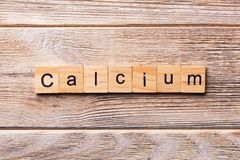 CALCIUM word written on wood block. CALCIUM text on wooden table for your desing, concept royalty free stock photography