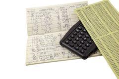 Calcolatore del registro di concetto della gestione del denaro Fotografie Stock