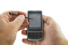Calcolatore di Handhedl in mani Immagini Stock