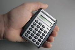 Calcolatore a disposizione Immagini Stock
