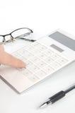 Calcolatore e penna con i vetri Immagine Stock Libera da Diritti