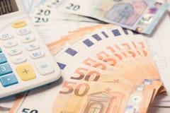 Calcolatore e soldi dell'euro immagini stock