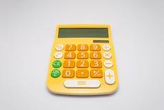 Calcolatore giallo luminoso con la pila solare, isolata fotografie stock libere da diritti