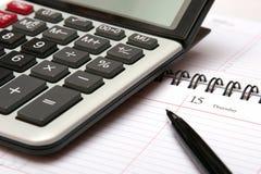 Calcolatore, organizzatore e penna Fotografia Stock