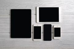 Calcolatori del ridurre in pani e telefoni mobili Fotografie Stock