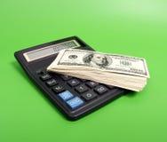 Calcoli e soldi fotografie stock