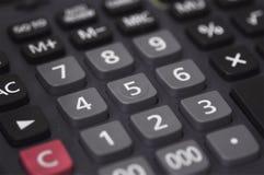 Calcoli vicino su Fotografia Stock