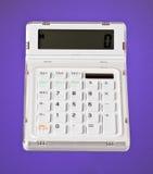 Calculadora branca no roxo imagens de stock royalty free