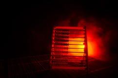 Calculadora chinesa com os grânulos coloridos no fundo alaranjado da obscuridade do fumo do fogo Foto do negócio, criança do conc Fotografia de Stock Royalty Free