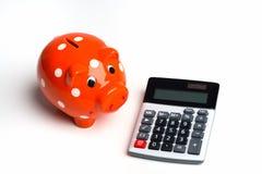 Calculadora com banco Piggy Fotografia de Stock Royalty Free