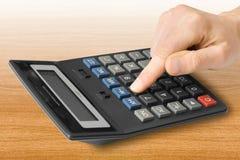 Calculadora com dedo Fotos de Stock Royalty Free