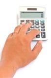 Calculadora com a mão isolada Imagem de Stock Royalty Free