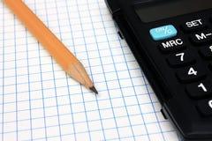 Calculadora com o lápis no caderno Imagens de Stock Royalty Free