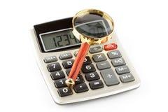 Calculadora com uma ampliação Imagens de Stock Royalty Free