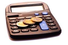 Calculadora con el dinero Foto de archivo libre de regalías