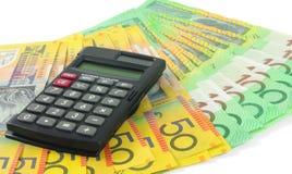 Calculadora con el dinero Fotos de archivo