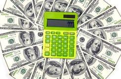 Calculadora con el dinero Fotos de archivo libres de regalías
