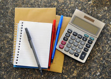 Calculadora con la libreta Fotografía de archivo libre de regalías