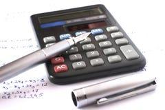 Calculadora con la pluma y la álgebra Foto de archivo libre de regalías