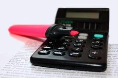 Calculadora con una etiqueta de plástico Fotografía de archivo
