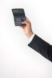 Calculadora da terra arrendada da mão Fotos de Stock Royalty Free
