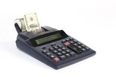 Calculadora de escritorio de cinta de papel con los billetes de dólar del americano ciento del dinero Imagen de archivo libre de regalías