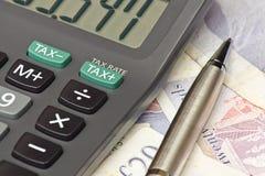 Calculadora de la declaración de impuestos Imagenes de archivo