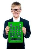 Calculadora de la explotación agrícola del muchacho de escuela upside-down Fotografía de archivo