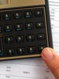 Calculadora del beneficio Foto de archivo