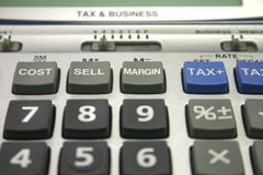 Calculadora del impuesto y del asunto Fotografía de archivo