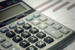 Calculadora do foco seletivo no original da carta fotografia de stock royalty free