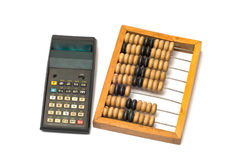 Calculadora e ábaco de madeira. Fotos de Stock