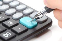Calculadora e ballpoint imagens de stock royalty free