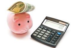 Calculadora e banco piggy Fotografia de Stock