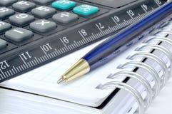 Calculadora e caderno Imagem de Stock