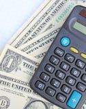 Calculadora e dólares Fotografia de Stock