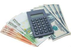 Calculadora e dinheiro Imagens de Stock Royalty Free
