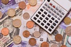 Calculadora e dinheiro Foto de Stock