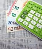 Calculadora e euro- notas de banco Fotografia de Stock