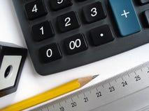 Calculadora e lápis Fotografia de Stock Royalty Free