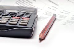 Calculadora e lápis Imagens de Stock