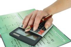Calculadora e mão Imagens de Stock