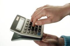 Calculadora e mão Imagem de Stock